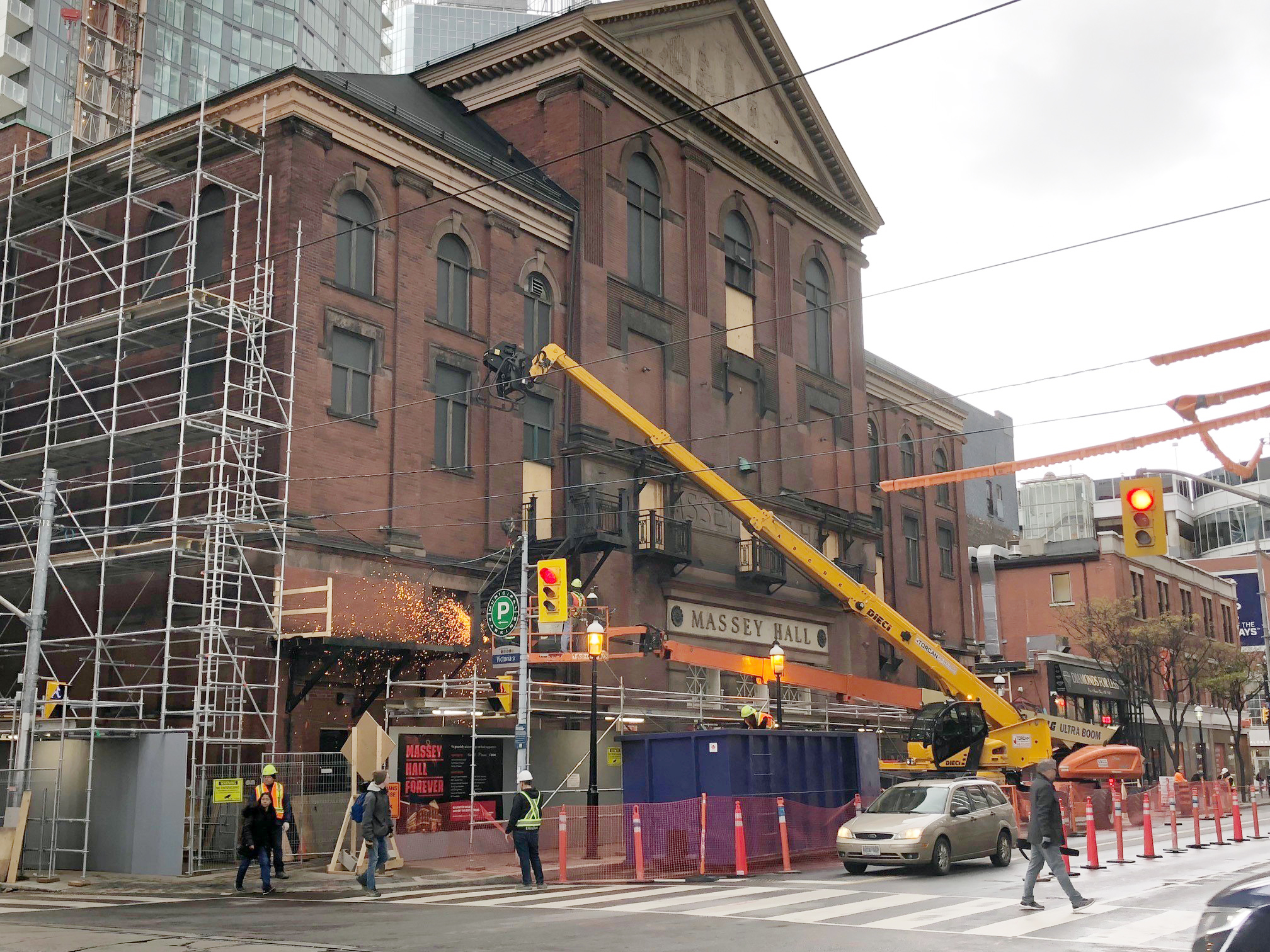 A construction crew removes the fire escape from Massey Hall in Toronto on Nov. 8, 2018. CITYNEWS/Christine Chubb