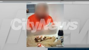 An inmate is seen with a steak and lobster meal, a bottle of root beer as well as a cell phone at the Toronto South Detention Centre. His identity cannot be revealed due to a publication ban. CITYNEWS.