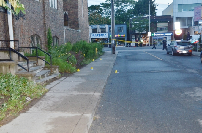 The west sidewalk of Bowden Street across the street from 7Numbers restaurant after a mass shooting in Toronto on July 22, 2018. Yellow evidence markers indicate the locations of five brass cartridge cases that were found. HANDOUT/SIU
