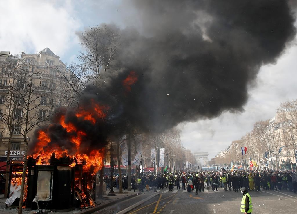 French yellow-vest protesters vandalise shops on Champs Elysees