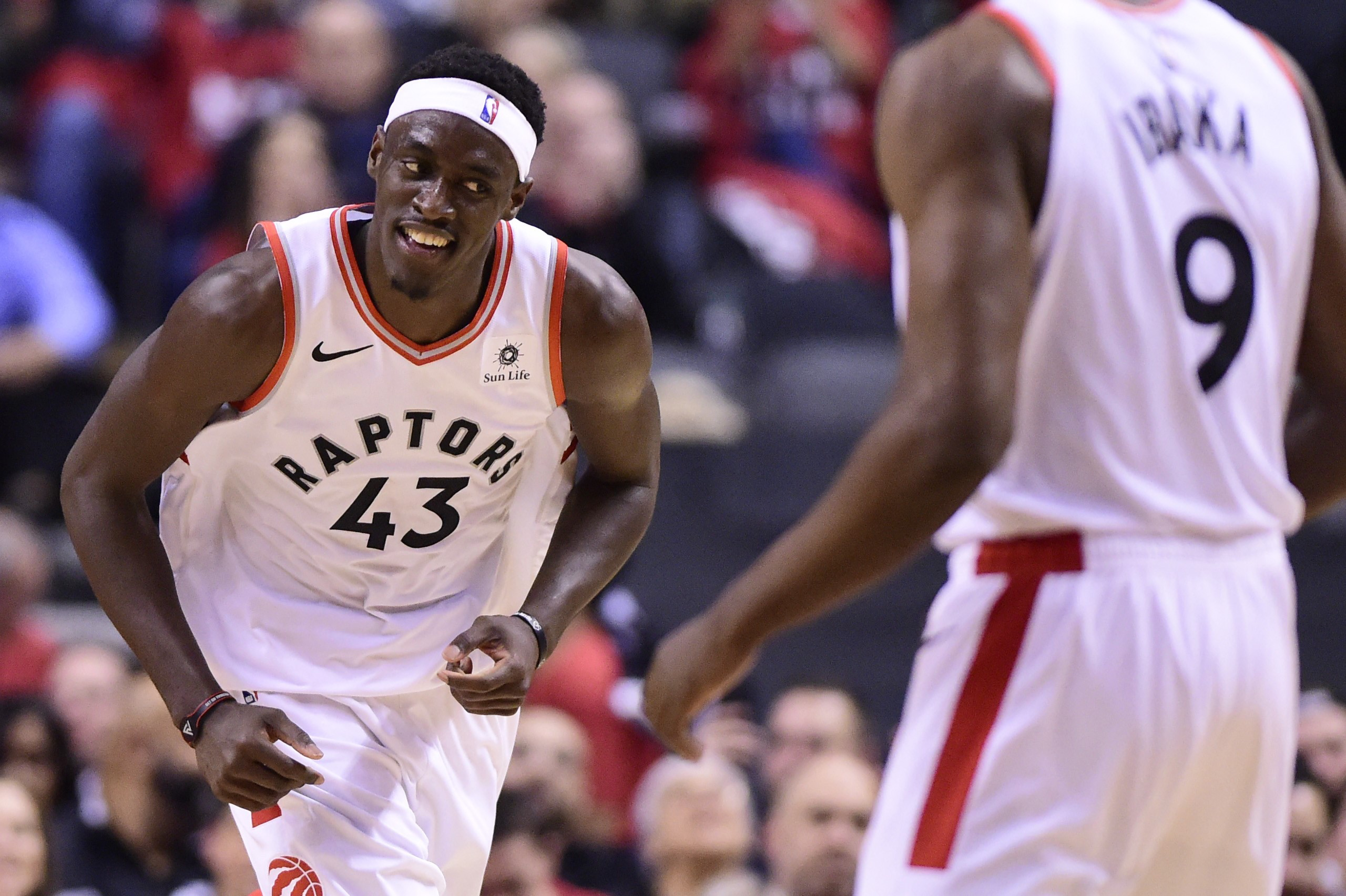 Toronto Raptors forward Pascal Siakam (43) smiles as he celebrates a dunk against the Orlando Magic during second half NBA basketball playoff action in Toronto on April 23, 2019. THE CANADIAN PRESS/Frank Gunn