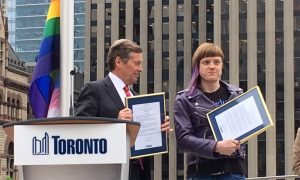 Toronto Mayor John Tory with Pride Toronto board member Christin Milloy at the Pride flag-raising at Toronto City Hall, June 4, 2019. MARK DOUGLAS/680 NEWS