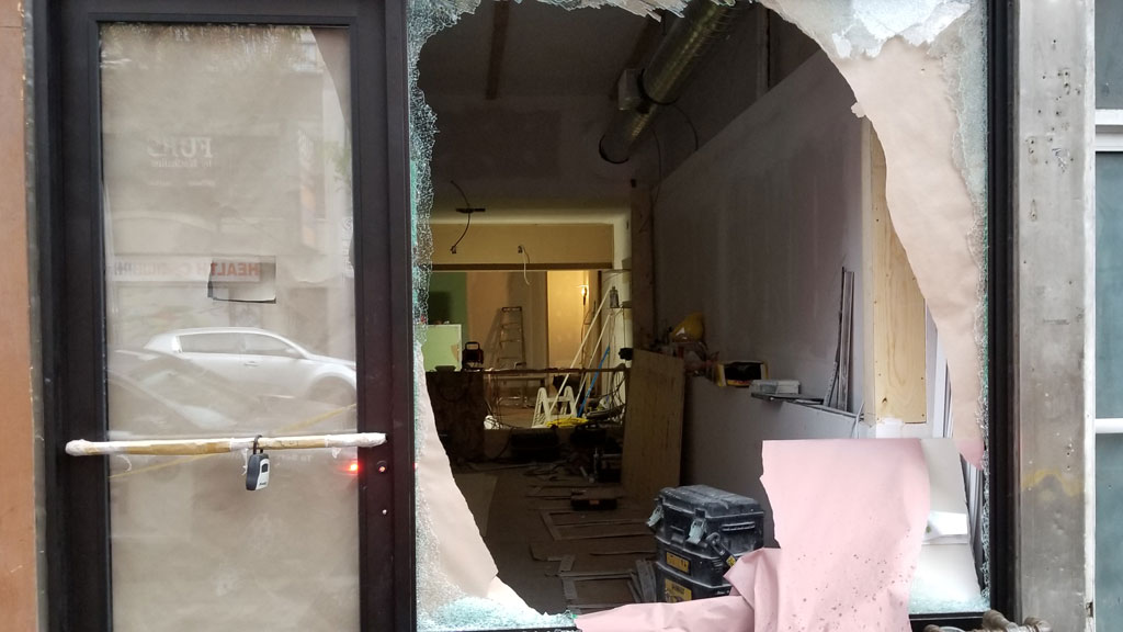 Gunfire shatters the glass of a unit under construction after a shooting on Queen Street West near Spadina Avenue on June 5, 2019. CITYNEWS/Bert Dandy