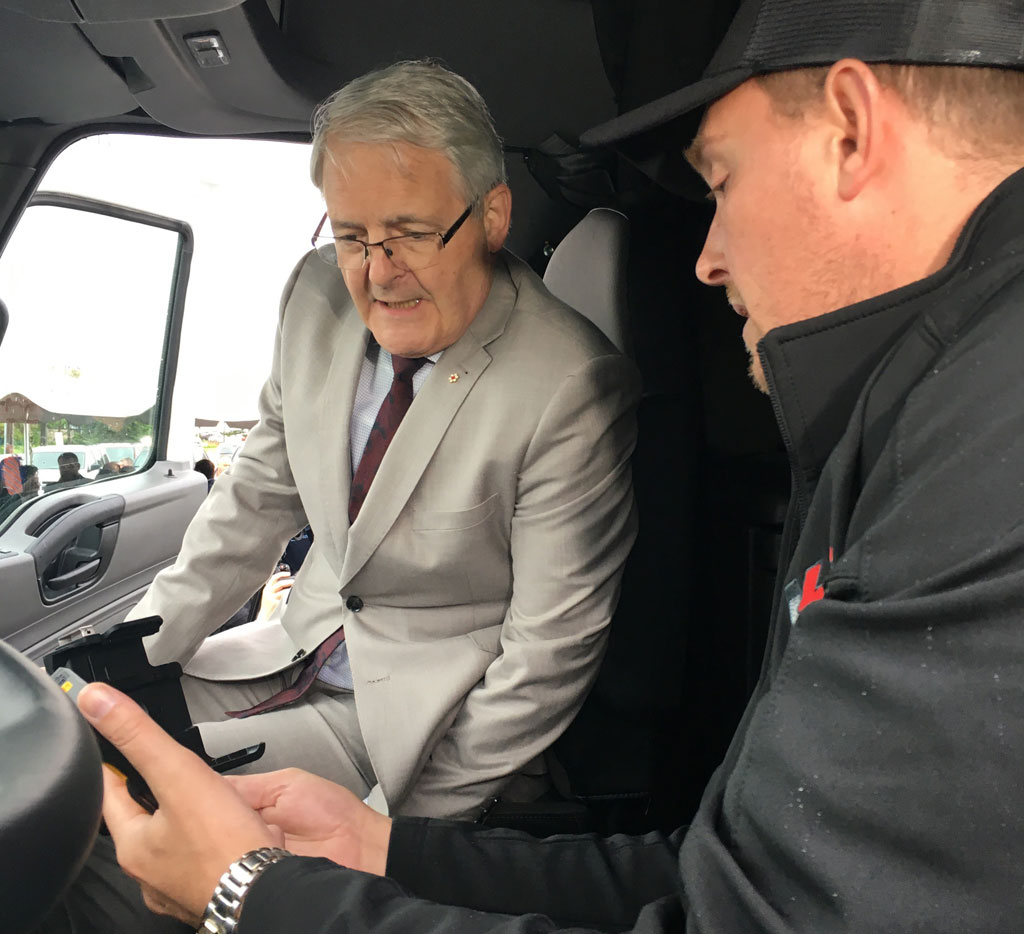 Transport Minister Marc Garneau examines an electronic logging device in a truck in Toronto on June 13, 2019. CITYNEWS/Jason MacLellan