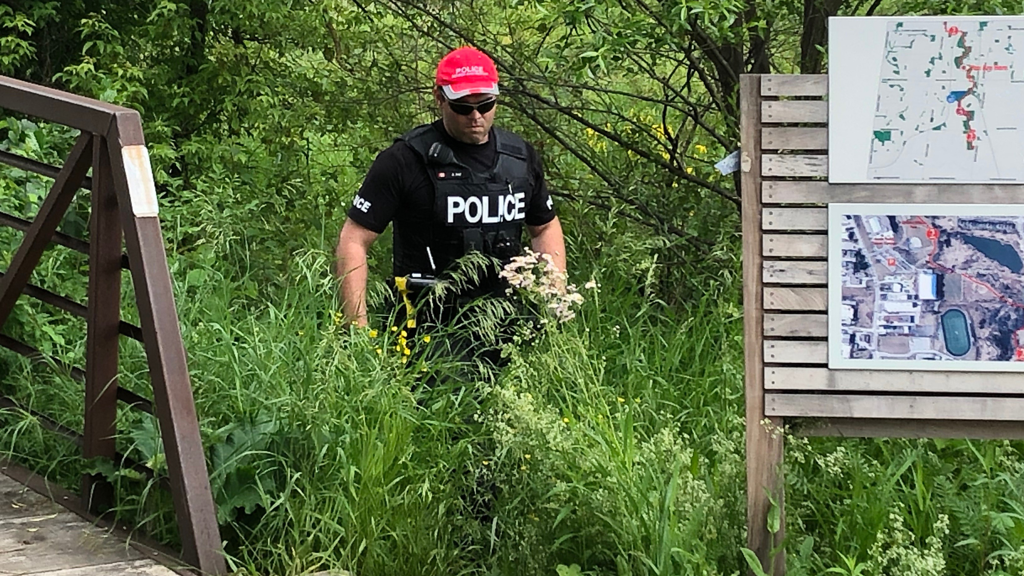 Police search trail in Aurora for evidence of sexual assault, June 25, 2019.