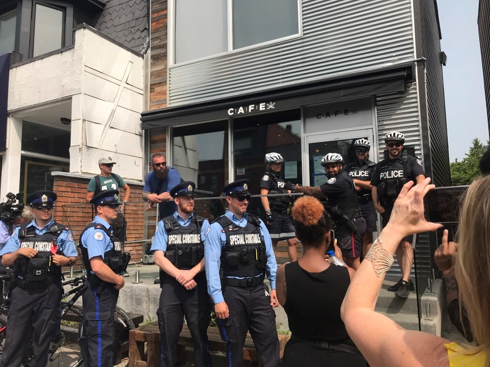 Police raid CAFE dispensary on Harbord Street, seizing bags of weed