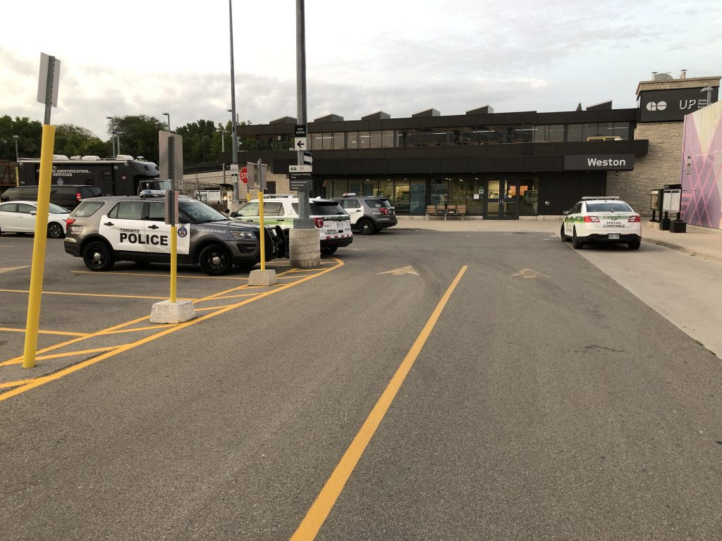 Police cars outside of the Weston GO Transit station