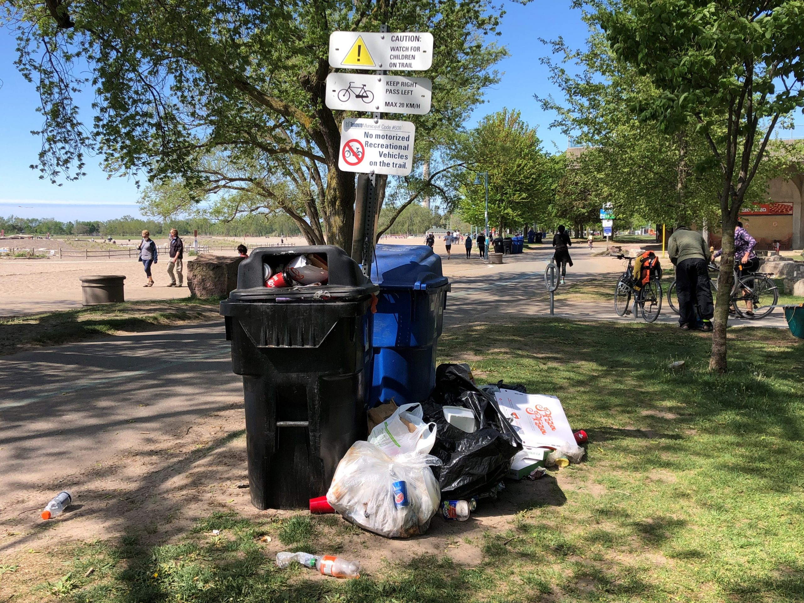 Garbage cans overflowing at Woodbine beach following a large gathering on May 23, 2021. CITYNEWS/Jerome Gange