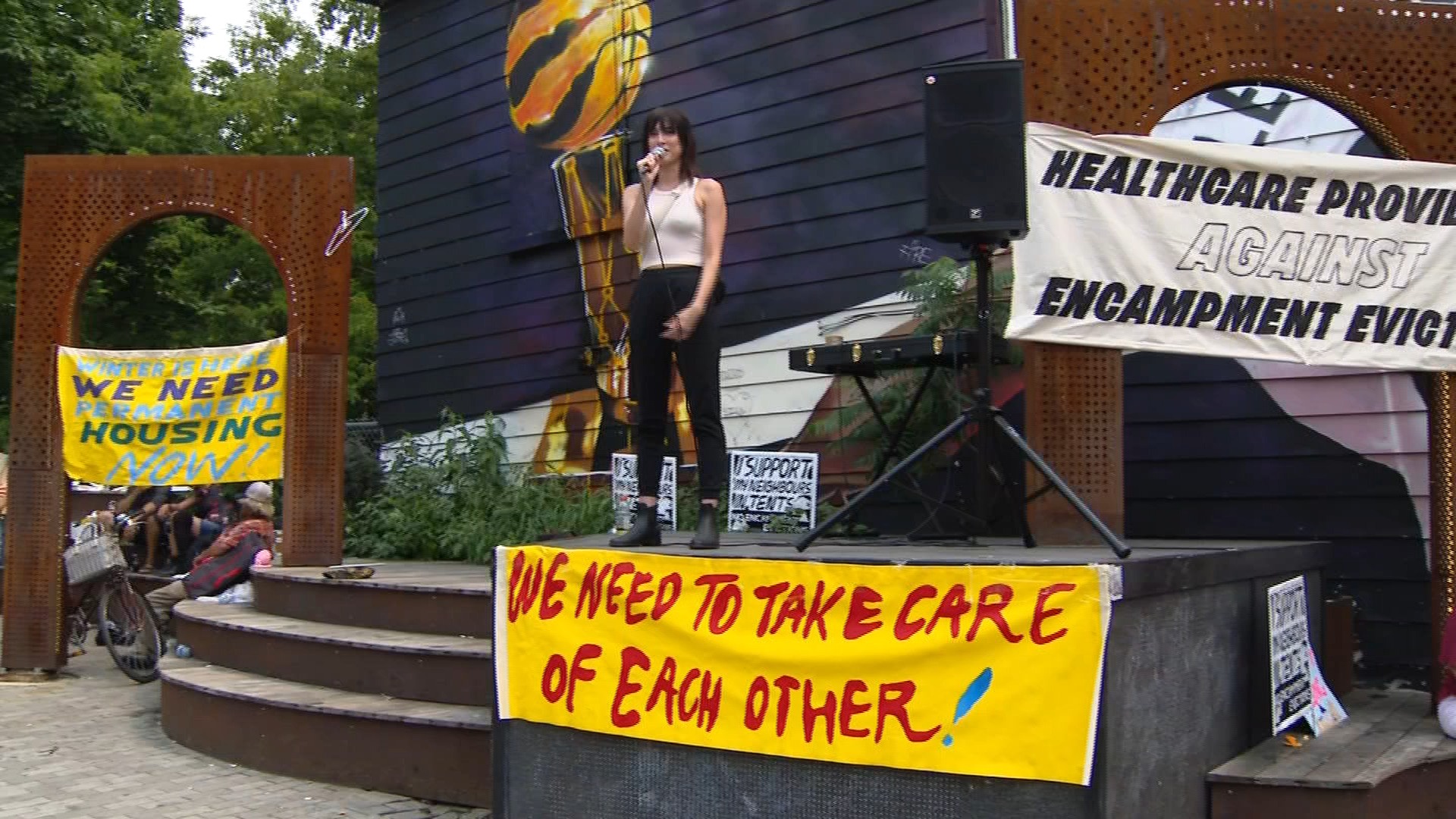 Diana Chan McNally, training and engagement coordinator for the Toronto Drop-In Network, speaks at a demonstration in support of unhoused park residents who were evicted from Alexandra Park by the city on July 20, 2021. CITYNEWS
